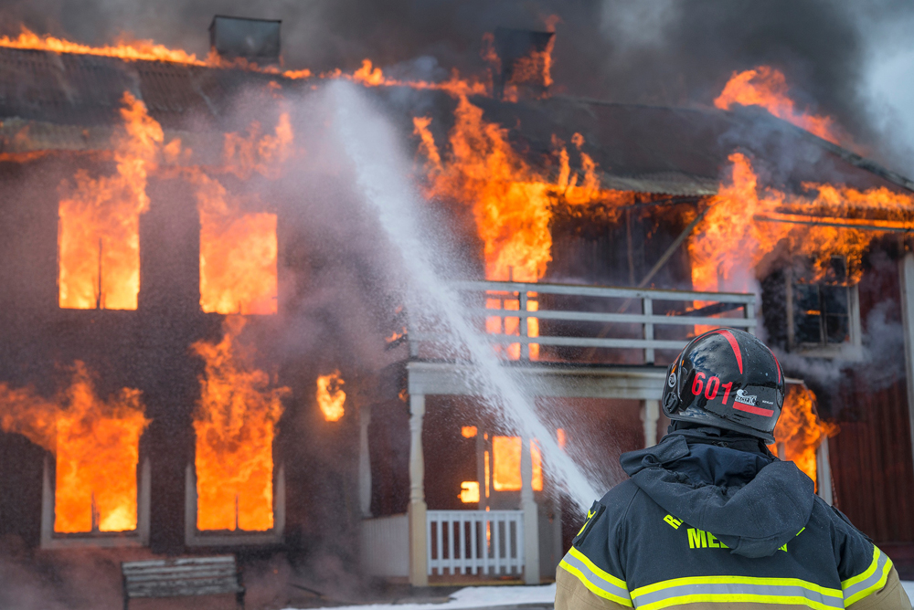 image showing a house on fire